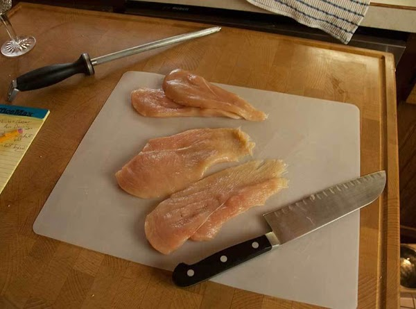 Cut the batard in half, and the split lengthwise to make two sandwiches.