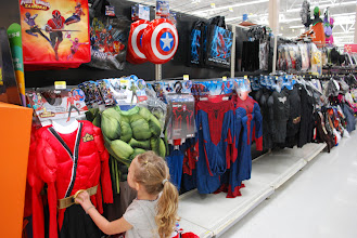 Photo: Checking our the Avengers gear. I totally want a shield!