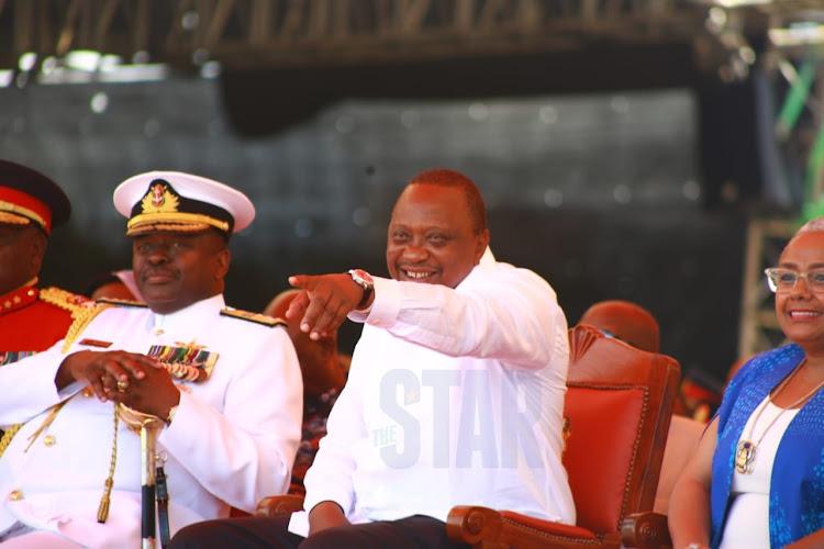 President Uhuru Kenyatta and and Chief of Defence Forces Samson Mwathethe.