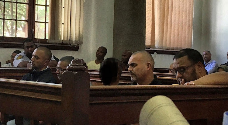 Nafiz Modack, Colin Booysen, Ashley Fields (obscured), Jacques Cronje and Carl Lakay in the dock at Cape Town Magistrate's Court on Tuesday.