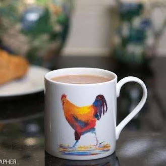 a china mug with a chicken printed on it