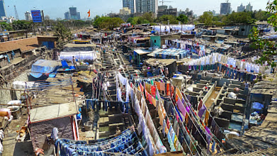 Photo: Dhobi Ghat outdoor laundry. A household can have all of their laundry done for about $1.  All items are double tagged so the rightful owner is known; they're washed/dried together, then sorted, packaged and delivered.http://en.wikipedia.org/wiki/Dhobi_Ghat