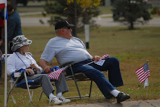 Photo: A couple waits for the Patriot Guards flag line to begin.