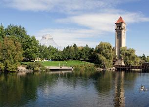 Photo: The Spokane, WA, clock tower and Pavilionas seen from the banks of the Spokane River. (Photoby Raymond Thompson)