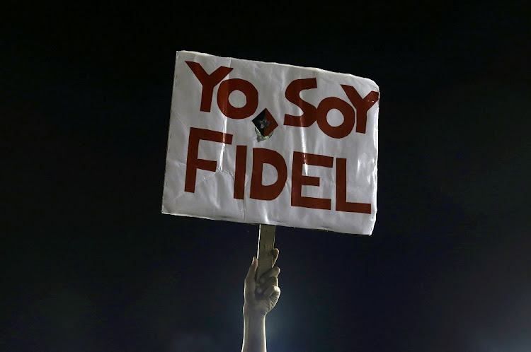 "A man holds a sign reading ""I am Fidel"" at a tribute to former Cuban leader Fidel Castro in Santiago de Cuba, Cuba, on Saturday. Picture: REUTERS"