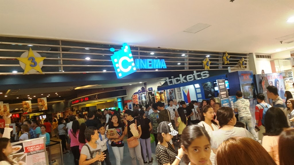 AT THE SM MEGAMALL CINEMA.