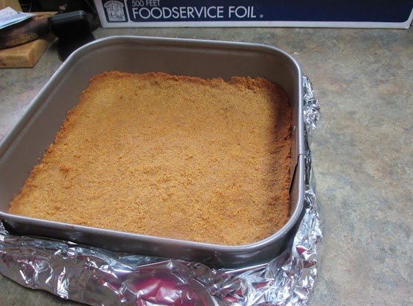 When crust has cooled, line bottom of pan with double layer of aluminum foil,...
