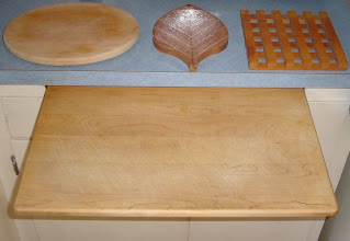 Photo: Three Cutting boards and a trivet. Making cutting boards is sort of silly. Pier One sells many different styles for $7 that use exotic wood. If you have a special need they are relatively easy little projects.