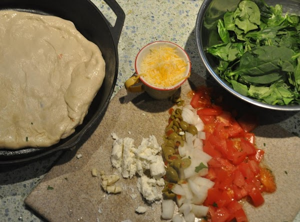 Heat the oven at 375 degrees. Cover a  large cast iron skillet with...