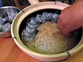 Photo: topping the noodles with shrimp