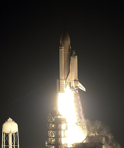 Space Shuttle Endeavour lights up the night as it blazes into space after an ontime liftoff.