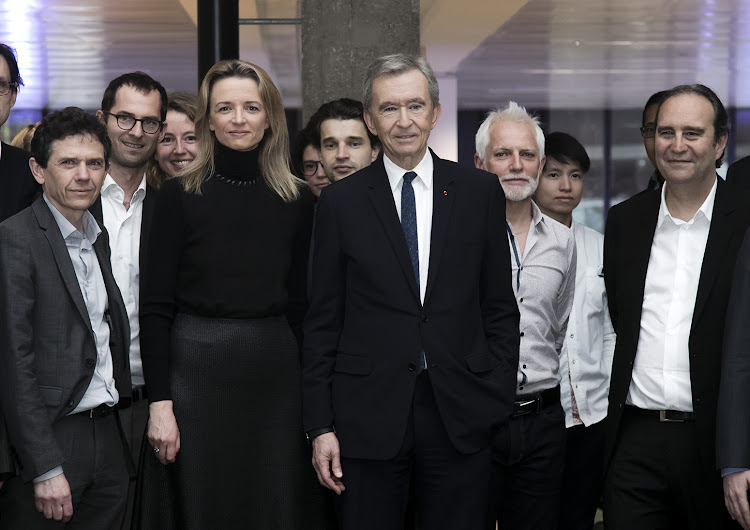 Delphine Arnault, Deputy Chief Executive Officer of Louis Vuitton, Bernard Arnault (C), CEO of the LVMH group.