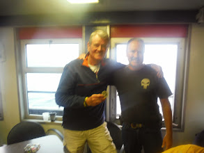 Photo: Day 40 Manitowoc to Ludington MI  Jim meets Matter, who is active in MIA*POW and he gives Jim, and Dale commemorative coins