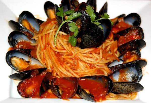 Fresh Mussels Simmered In A Tomato-herb Broth & Served Over Angel Hair Pasta With Just A Hint Of Spice!