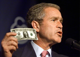 Photo: President Bush holds up the first dollar for America's Fund for Afghan Children as he speaks to the March of Dimes Leadership Conference meeting at the Omni Shoreham Hotel in Washington, Friday, Oct. 12, 2001. Bush said the dollar bill came from 6-year-old Justin Washington, a March of Dimes ambassador from Miami.  (AP Photo/J. Scott Applewhite)