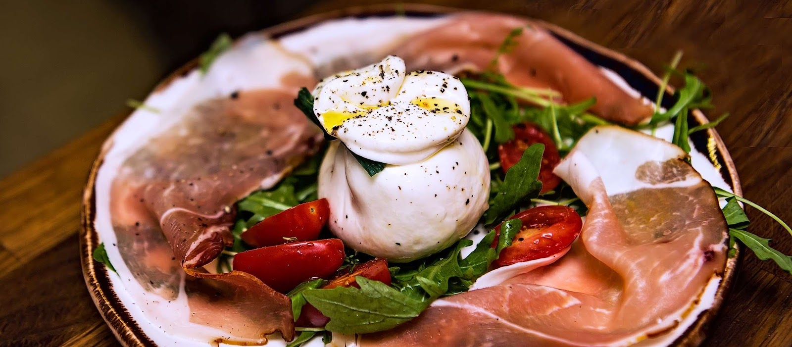 Burrata cheese, speck , mini san marzano tomatoes