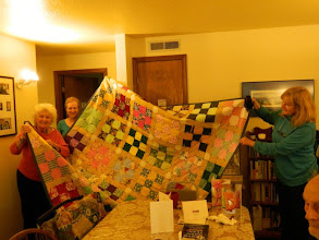 Photo: Mari win's the quilt at the school auction
