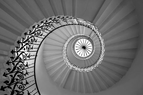 Spiraling Upwards by Adrian Campfield - Black & White Buildings & Architecture ( interior, uk, patterns, monochrome, spiral staircase, black and white, buildlings, round, queen mother house, curves, greenwich, city, lily spiral staircase, england, stairs, london, abstracts, dark, lines, mono, light,  )