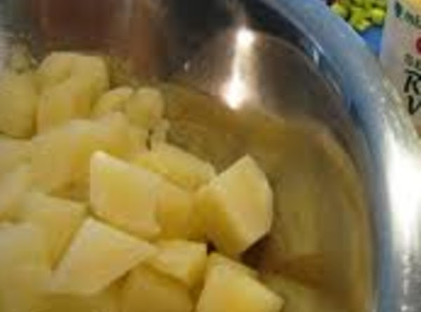 Cook your diced potatoes in boiling water about 12 minutes; drain and rinse in...