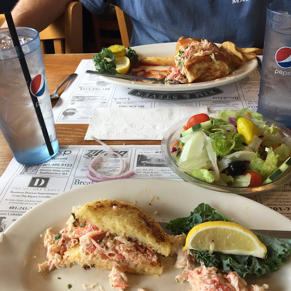 my half eaten lobster roll in front and my husbands regular lobster roll in back