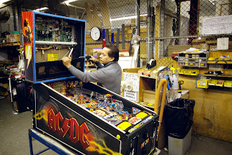 Photo: Dusting off the pinball machine before packing