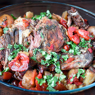 LEG OF LAMB RECIPE WITH POTATOES AND TOMATOES IN CROCK POT.