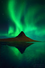 """Photo: """"The Aurora Spirits""""  """"And even though the eyes had seen so much beauty, the enchantment of the Aurora would steal the crown of the most magnificient spectacle of light ever witnessed...""""  José Ramos ©  A northern lights shot in Kirkjufell, made during my seven day trip to Iceland in September. After sleeping inside the rental car in Keflavik (the plane arrived at 1am), I decided to head to Kirkujfell next day. I had seen this mountain so many times on 500px and other galleries, and yet it still kept me fascinated every single time with its singular shape, frequently adorned by beautiful waterfalls. As soon as I arrived I could feel my heart racing with the excitement, and I rushed to the spot and photographed it from many angles until it was absolutely dark. Finally headed to the car, parked right before the path to the waterfalls, to grab something to eat, and waited on the inside for sleep to come. The sky had been partially filled with clouds, as it usually happens in Iceland, and I was nowhere near from thinking about watching an Aurora Borealis/Northern Light during my whole trip (due to their rarity), let alone seeing it on the first day!  It all happened very quickly, and started with my girlfriend's scream, """"AURORA!"""". We rushed to the outside, and time suddenly stopped while I glanced at the sky, feeling mesmerized with the light dance spectacle right in front of me. Then a thought instinctively appeared amidst the emotional rush, """"my camera! Where is it?!"""". Chaos ensued, and in 2 minutes I was ready to start shooting. There was the option of returning to the waterfall spot, but it would take too much time (minutes are precious, as Auroras can dissapear in seconds), so I ended up going to the beach right by the mountain and started shooting.  It's not easy to photograph this type of scene. ISO needs to be at 1600-3200 and the lens set at maximum aperture, to maximize exposure. Shutter speed is usually between 10-30 seconds, and longer than 30 seconds"""
