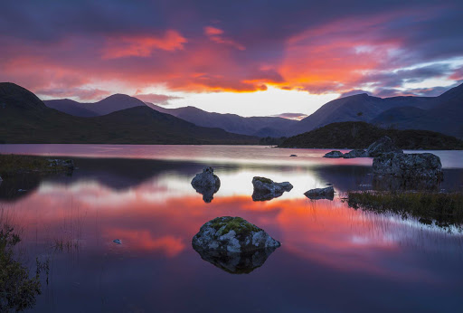Sunset at Lochan na h-Achlaise on Rannoch Moor in central Scotland.