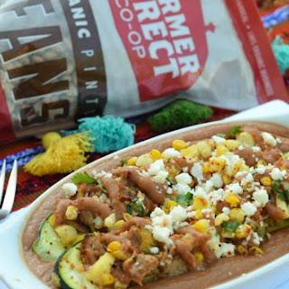 Carnitas & Street Corn Stuffed Zucchini with Ole Frijoles Pinto Bean Sauce.