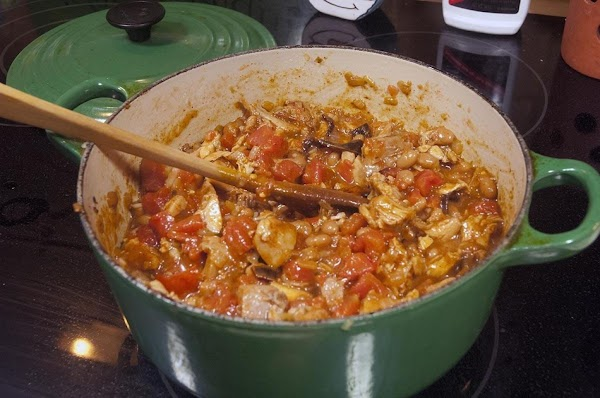 Stir the mixture while allowing it to return to a simmer.