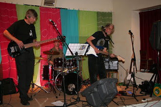 Photo: The Johnny Morris Experience (JMX - Vince Ash, Mike Malcher & Frank Bartucca) entertaining the Festival Party on Saturday night in the Village Hall.© Richard Bottle 2008