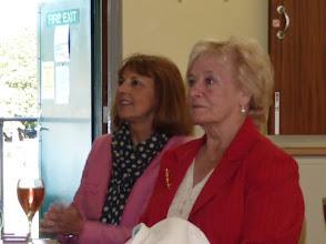 Photo: Gail Hall & Carole Davies watch the presentations.