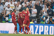 Mohamed Salah of FC Liverpool celebrates after scoring his team's first goal with team mates during the UEFA Champions League Final between Tottenham Hotspur and Liverpool at Estadio Wanda Metropolitano on June 1, 2019 in Madrid, Spain.