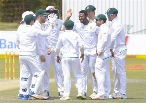 Andile Phehlukwayo of South Africa celebrates with teammates after taking a wicket during day 3 of the 1st Sunfoil Test match between South Africa and Bangladesh at Senwes Park on September 30, 2017 in Potchefstroom. Picture: GALLO IMAGES