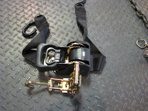 """Photo: Here the integrated """"seatbelt"""" ratchet/strap is compared to a short conventional ratchet. The hook would be removed from the ratchet and it would be through-bolted to a bracket on a chock. It is about 2"""" shorter than the upper one."""