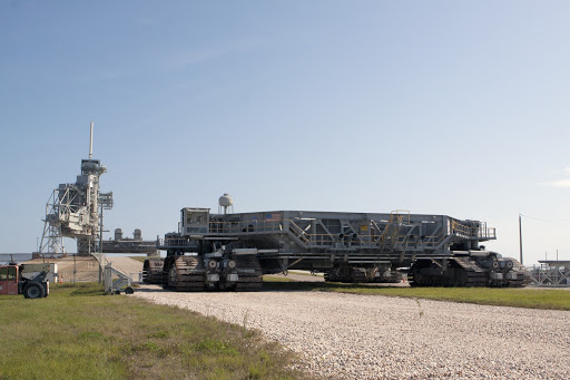 A crawler-transporter rolls toward Launch Pad 39A at NASA's Kennedy Space Center.