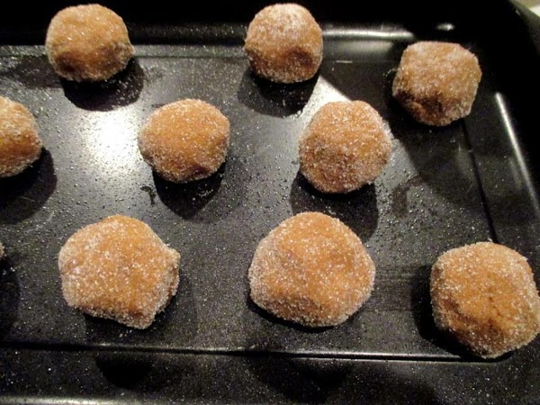 Make balls about the size of a golf ball. Roll to coat in sugar...