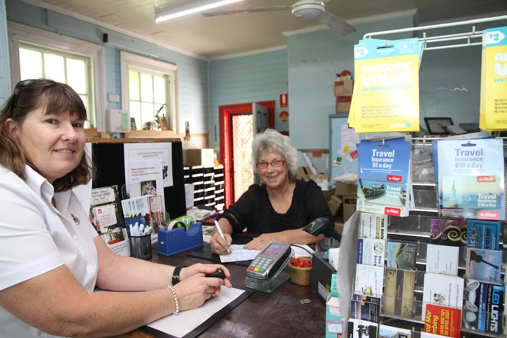 Narrabri West Post Office owner Cathy Redding, right, with customer Robyn Trindall.