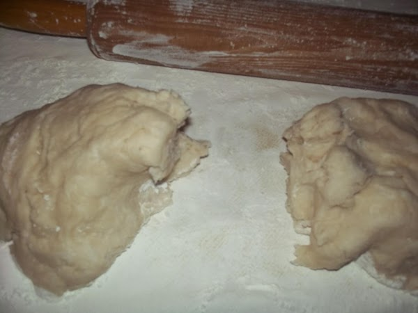 Divide dough in half and place one aside. Smear your rolling pin with the...
