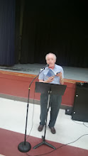 Photo: Ken Osborne reads one of his anthology contributions.
