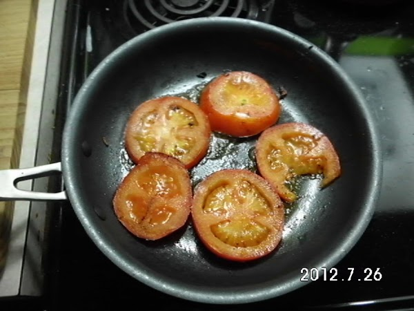 Cook sliced tomatoes in skillet used for heating steak.  Cook for a few...