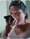 Woman speaks into mobile phone