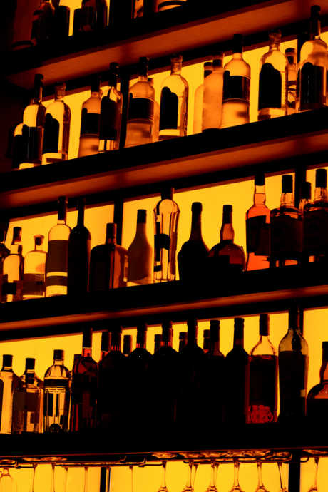 Flambé Desserts: Bottles of liquor on shelves. Choose alcohol that's 40-50% ABV for best results.