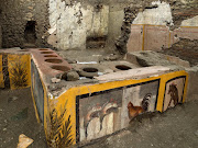 Frescoes on an ancient counter discovered during excavations in Pompeii, Italy, are seen in this handout picture released December 26, 2020.