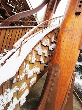 Photo: Snow on wooden panels of the tower at Cox Arboretum in Dayton, Ohio.
