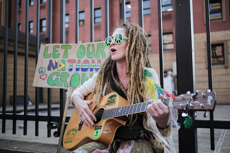 Caiti Woolcott plays guitar outside the North Gauteng High Court in Pretoria in support of the case brought by the Dagga Couple who have taken the fight to legalise Marijuana to court.