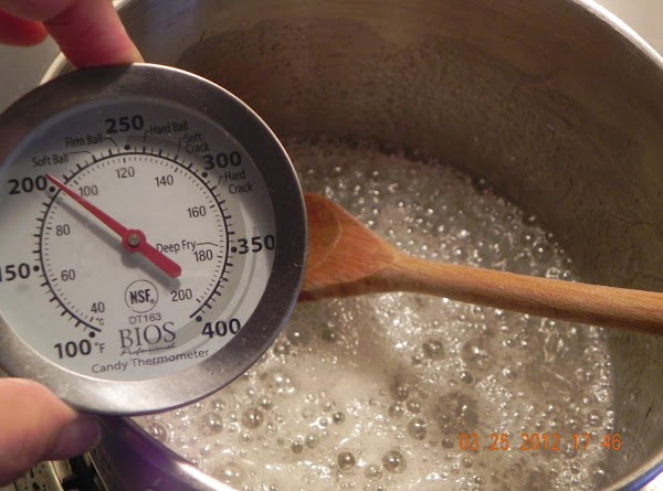 Combine sugar, corn syrup, and water; cook to thread stage (234 degrees).