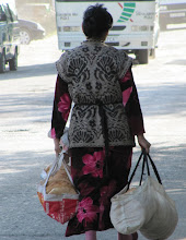 Photo: Day 166 - Woman With Her Bags of Bread