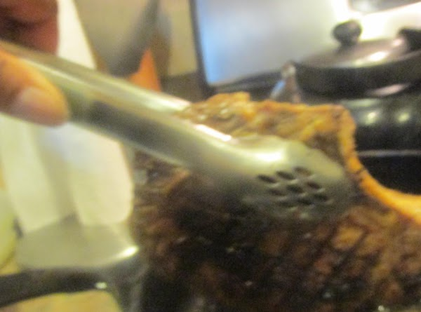 Sear the sides of the steak by holding up right with tongs, for about...