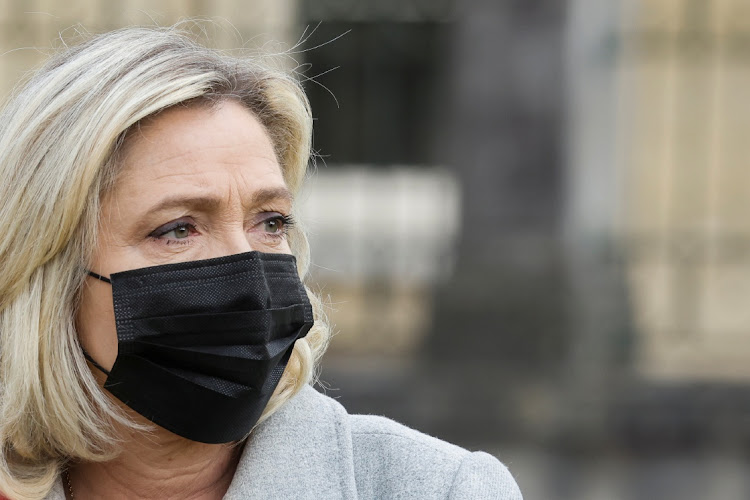 Far-right Rassemblement National (RN) party's president Marine Le Pen looks tweeted the images of Islamic State atrocities to highlight what she said was the absurdity of the comparison.